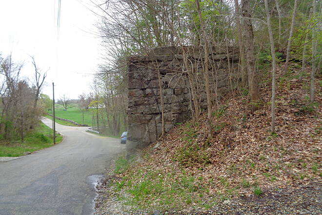 Air Line State Park Trail Needles Eye Road bridge abutmt Former bridge abutment at Needles Eye Road, Pomfert, CT on 5/4/16. Trail bypasses on the north side.
