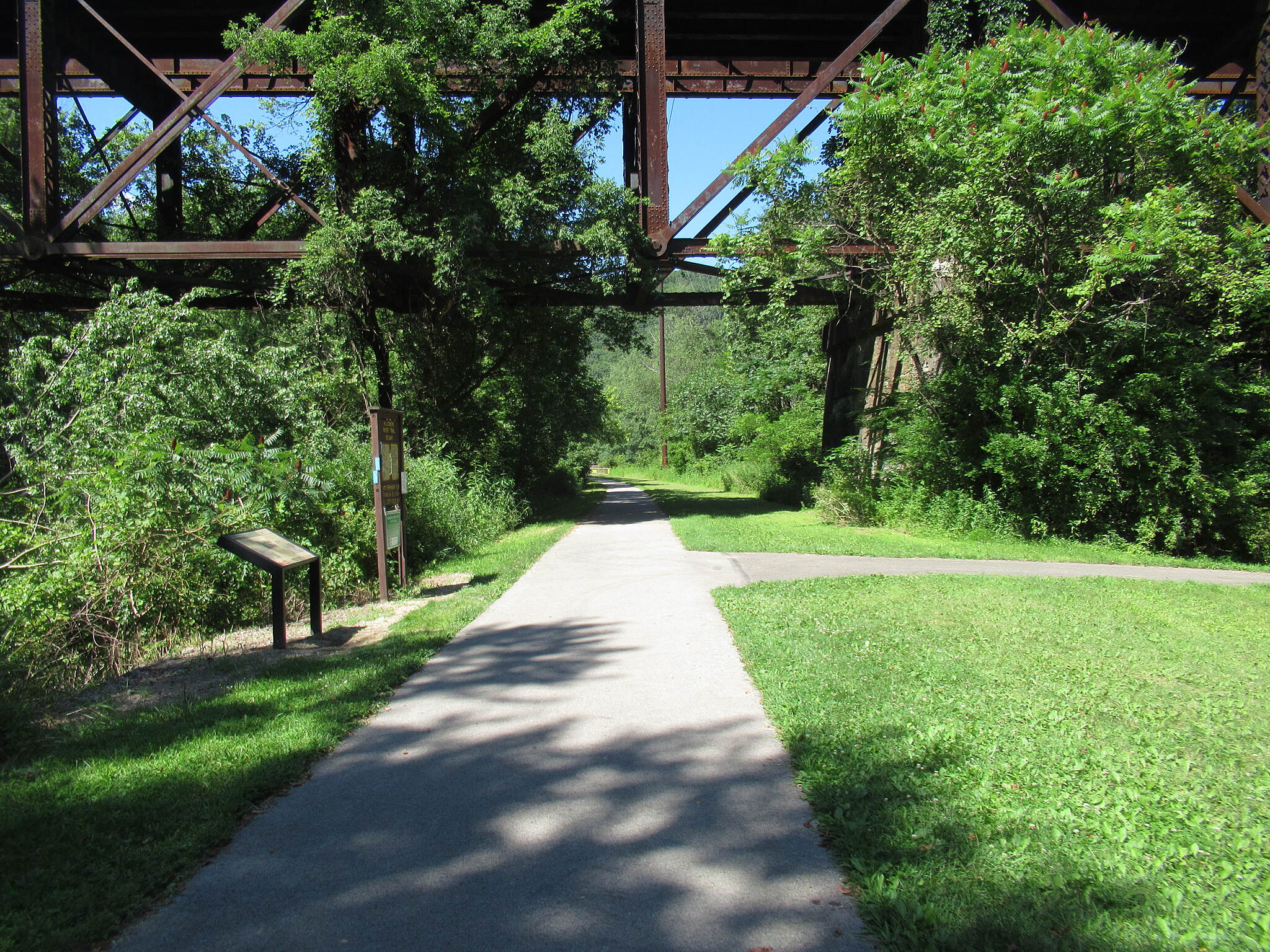 Allegheny River Trail Trail under the bridge Trail goes under the Belmar Bridge.  Up above is the Sandy Creek trail. July, 2019.