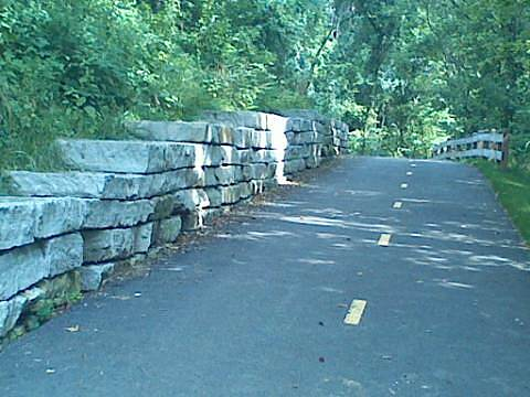 Alum Creek Greenway Trail Stone Wall This picture was taken along the section of the Alum Creek trail between Innis Park and Sunbury Road. Extremely large stones stacked to form this beautiful wall.