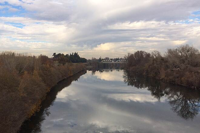 American River Bike Trail (Jedediah Smith Memorial Trail) Winter reflection from Guy West Bridge I caught this breath taking reflection from the Guy West Bridge near Sac State on the American River Bike trail in December.