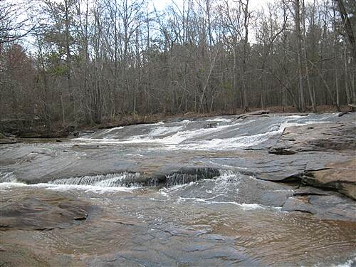 Arabia Mountain Trail Pole Bridge Creek Shoals Pole Bridge Creek cascades over shoals next to Flat Rock Trailhead off Evans Mill Rd.