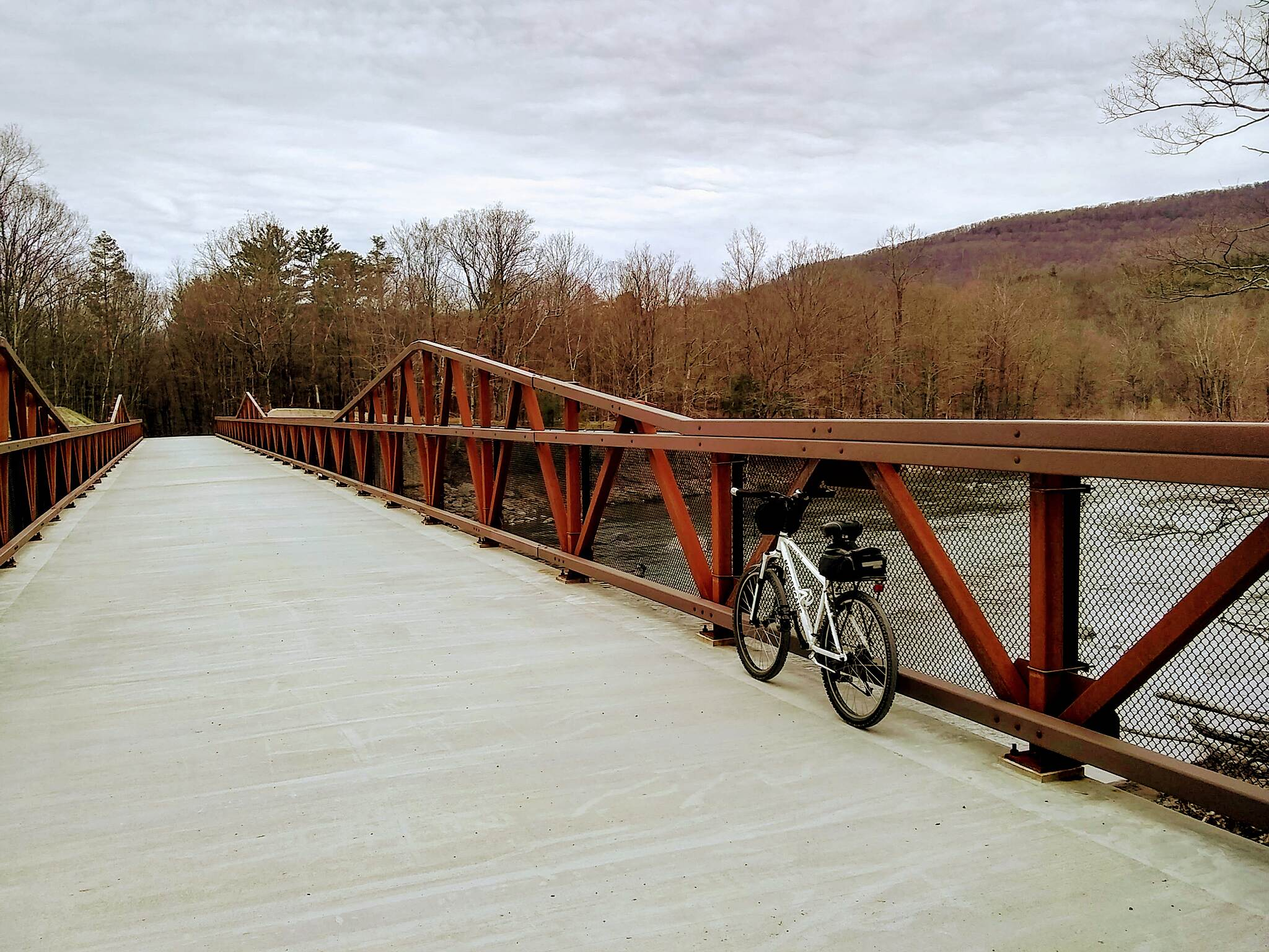 Ashokan Rail Trail First bridge on the western end over the Esopus Creek Several fly fishers were standing in the cold rushing waters in late April 2020.