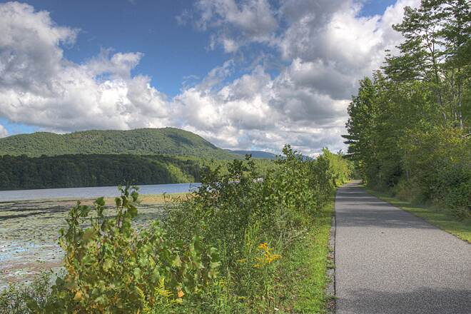 Ashuwillticook Rail Trail Cheshire Resevoir VIsta Ashuwillticook rail trail is easy on the eyes, paralleling lakes, wetlands, and the Hoosic River.