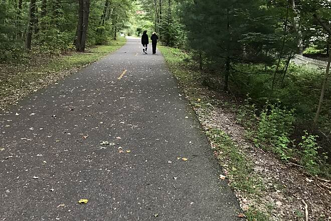 Assabet River Rail Trail Among the trees Hudson section near Stow