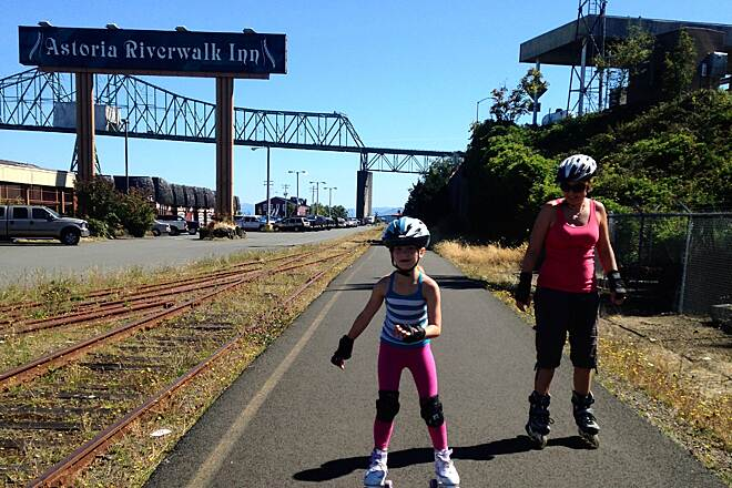 Astoria Riverwalk Astoria river walk trail Near the entrance to the Megler Bridge .... Great place to park for a short jaunt ( kid friendly ) is directly under the ' big bridge' at the fisherman's memorial near Holiday Inn and skate/ ride West.{ 2 well marked road crossings but little traffic }