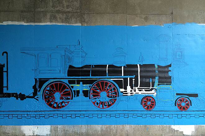 Auburn Trail Art on the Auburn Trail Victor Hiking Trails has commissioned Emily Waldman to paint a typical 1880's steam locomotive, coal tender, passenger car and caboose on the Thruway underpass.