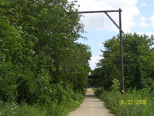 Badger State Trail  RR low clearance pole to alert any worker that was on top of the train of a low bridge or tunnel ahead.