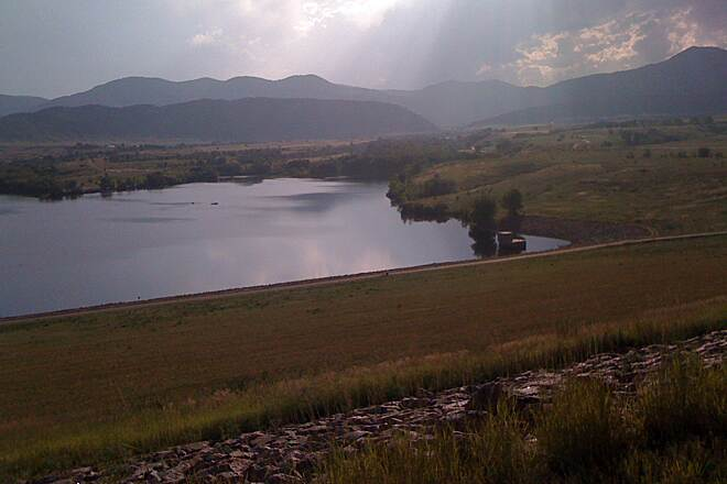 Bear Creek Trail (Denver) From the top of the dam Rain and sunbeams across the Front Range foothills.