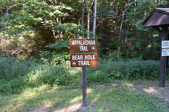 Bear Hole Trail Bear Hole Trail Sign at the trailhead east of the Waterville Bridge; the Bear Hole Trail turns northwest here, while the Appalachian Trail turns southeast.