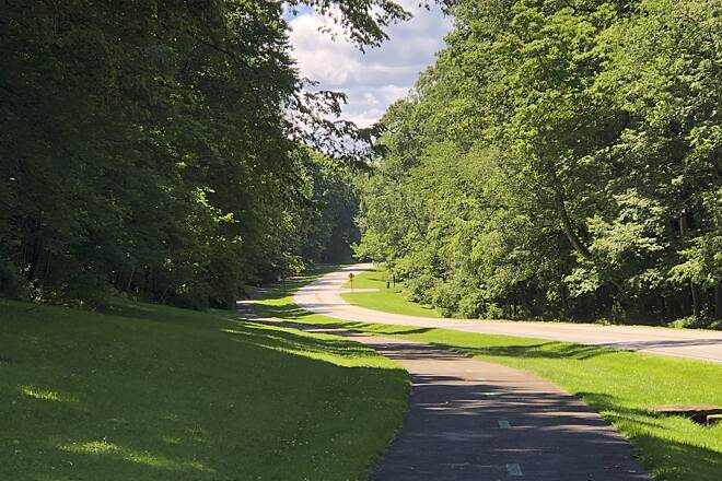 Bedford Reservation All Purpose Trail Pathway and Parkway Here is a view of the Bedford Reservation's All Purpose Trail as it parallels the main road through the park, the Hawthorn Parkway.  June 2019