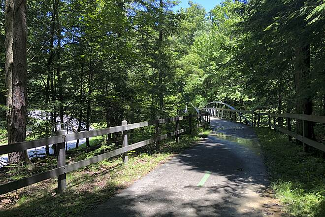 Bedford Reservation All Purpose Trail Trail Bridge near Bridal Veil Falls Here is a view of the shaded All Purpose Trail as it approaches a bridge over a small creek in the Cleveland Metroparks' Bedford Reservation.  June 2019.