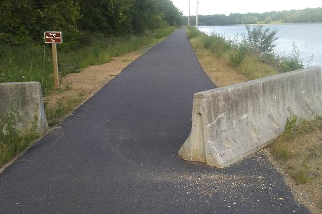 Ben Cardin C&D Canal Recreational Trail Ben Cardin C&D Canal Recreational Trail Beware the 'Jersey barrier' at the eastern terminus of trail on the Maryland/Delaware trail; it was still protruding into the greenway as of June 2017.