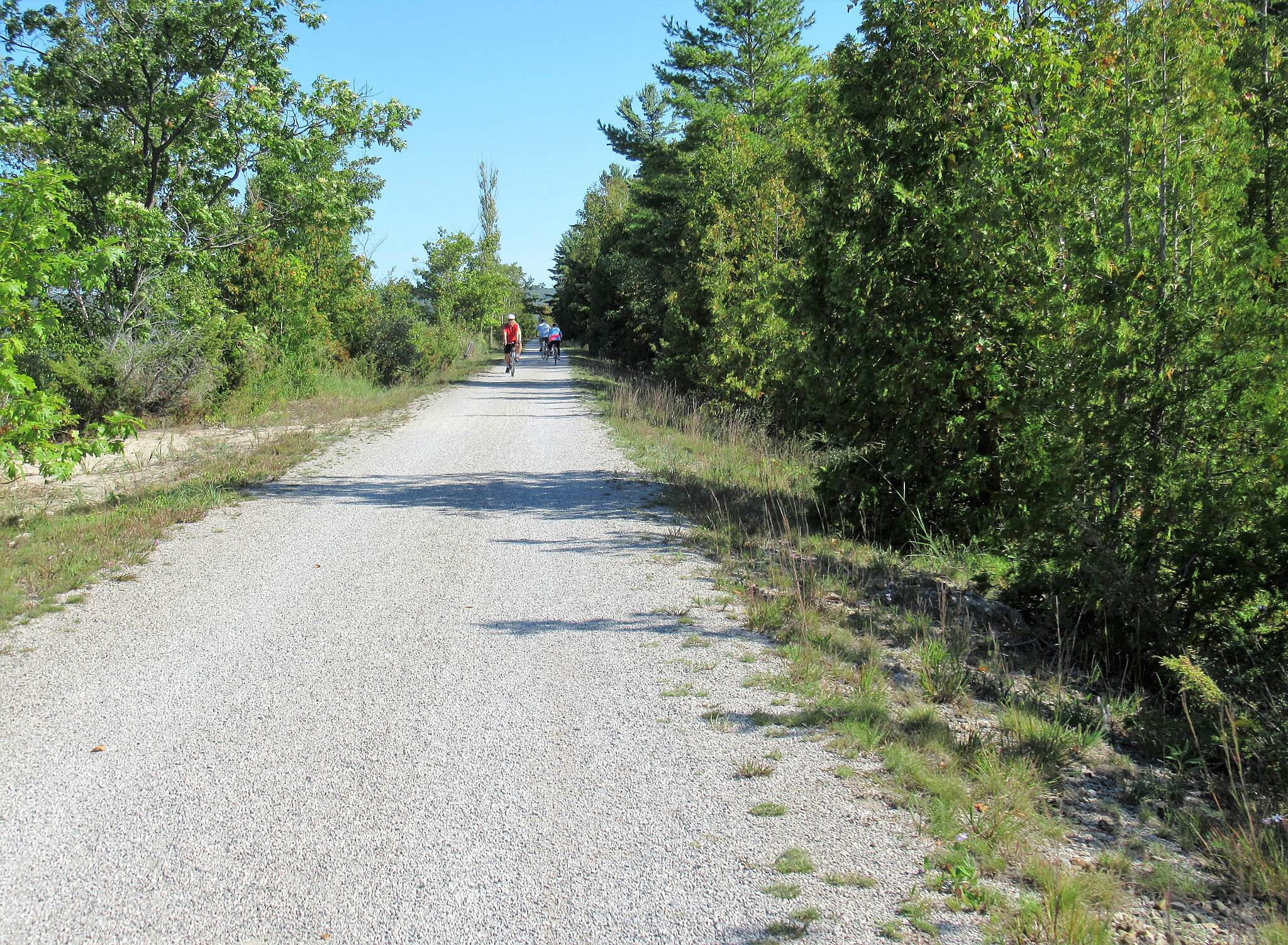 Betsie Valley Trail Cyclists along the trail Near Beulah, cyclists along the trail
