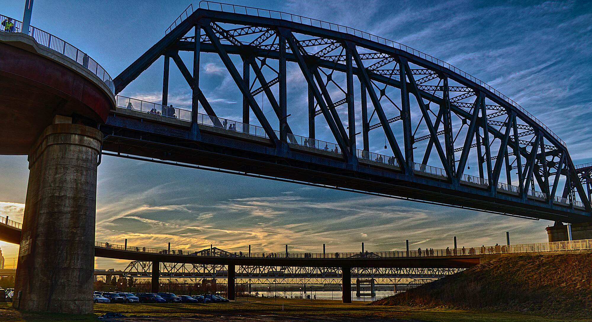 Big Four Bridge Busy Bridge The Big Four® is a popular place to view the sun setting over the Ohio River.
