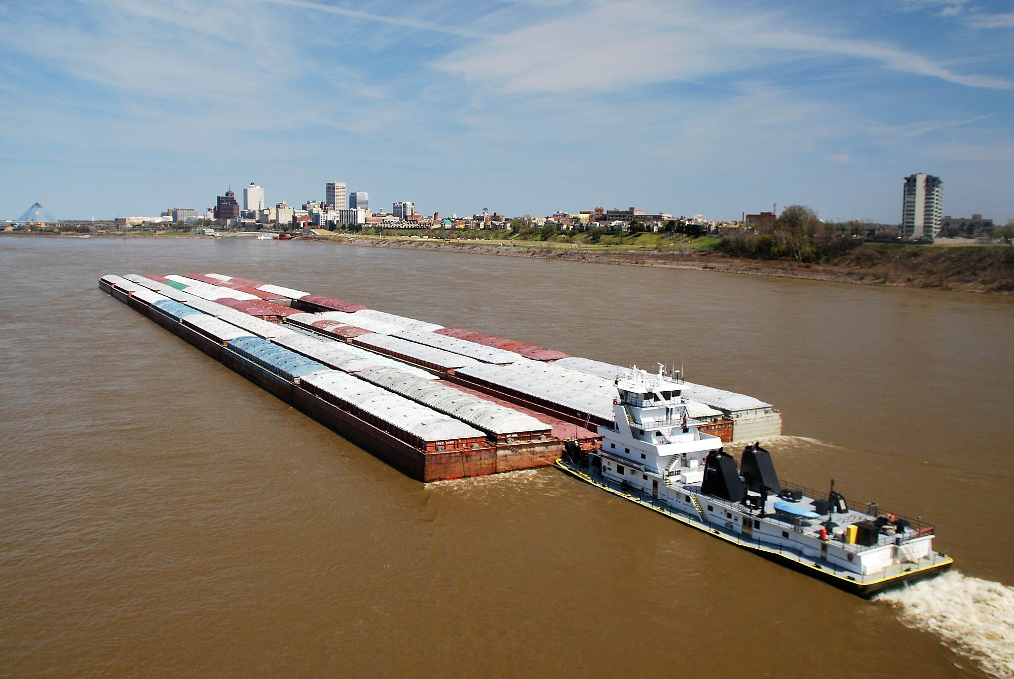 Big River Crossing Barge on the Mississippi There were several barges going up the river.