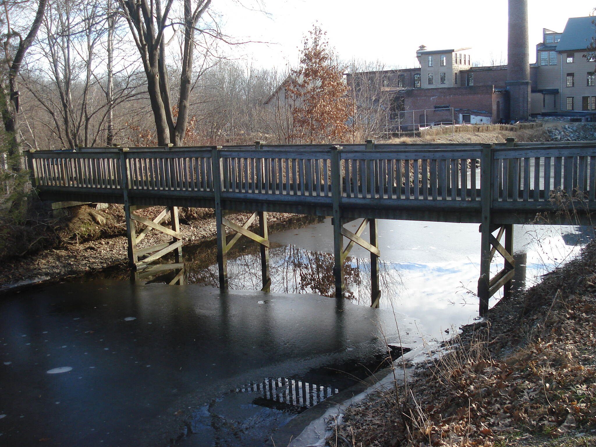 Blackstone River and Canal Heritage State Park Trail Trail bridge across the canal from the parking lot just north of the Stanley Woolen Mill