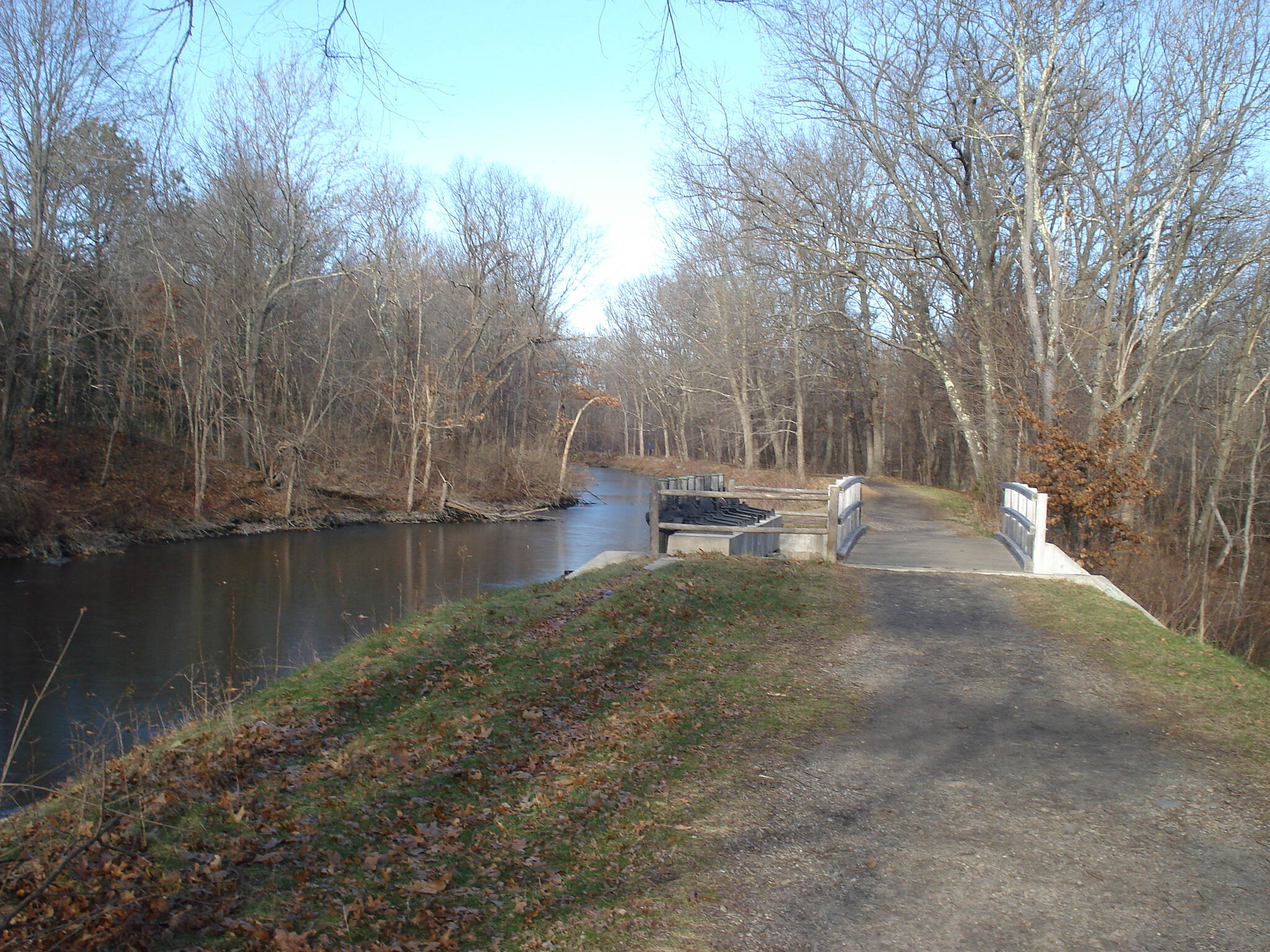 Blackstone River and Canal Heritage State Park Trail Looking north along the towpath towards the spillway north of the Stanley Woolen Mill with the canal on the left.