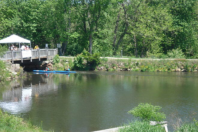 Blackstone River Greenway The bridge over the canal at Riverbend Farm with canoe racer passing below