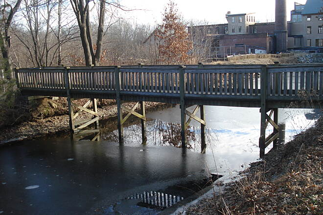 Blackstone River Greenway Trail bridge across the canal from the parking lot just north of the Stanley Woolen Mill