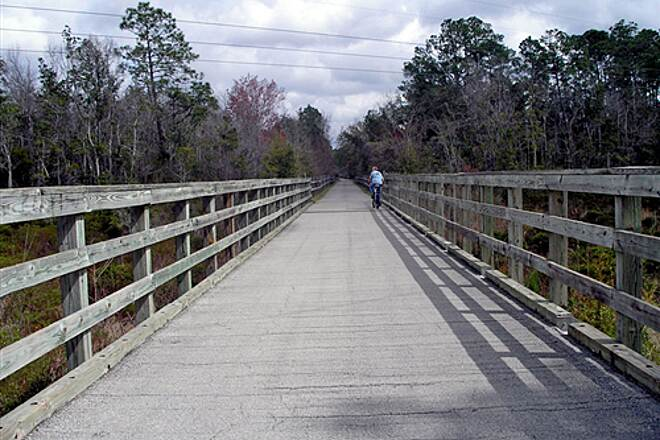 Blackwater Heritage State Trail   Riding across a long bridge