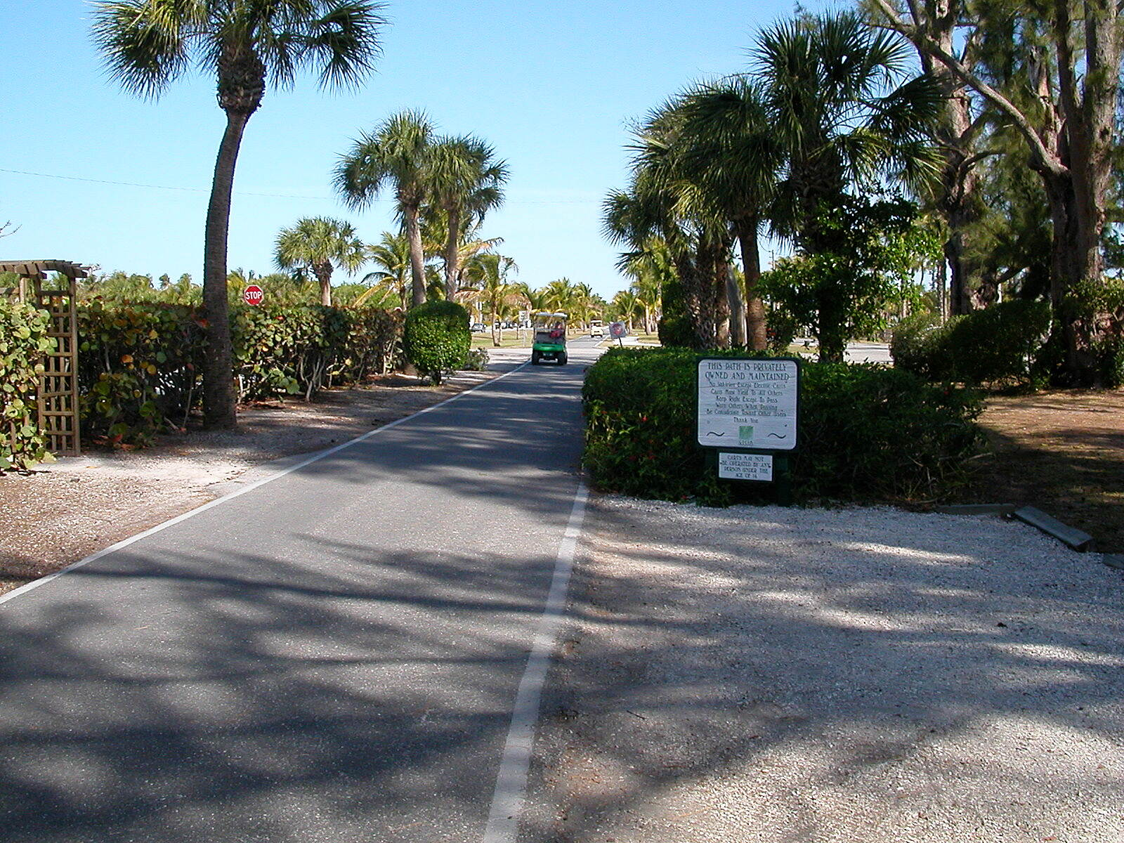 Boca Grande Bike Path Along the Trail An unusual trial feature - sharing the trail with golf carts.