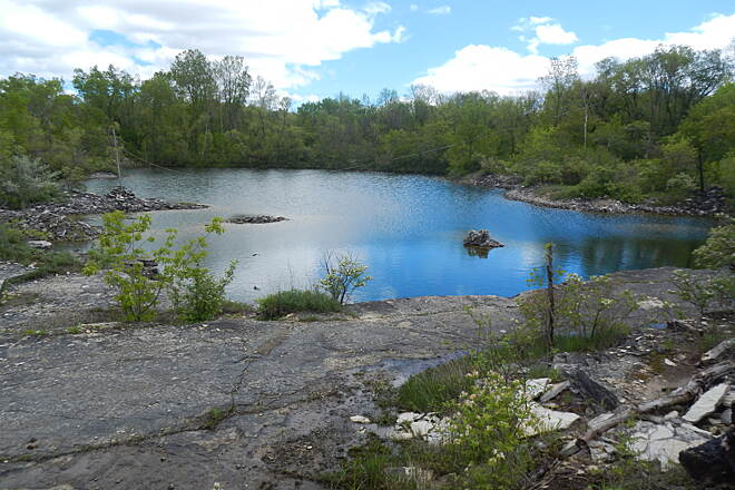 Bugline Trail Bugline - mile marker 3 - note all pics were taken in May & June 2017 Old, unused quarry on the west side of the trail.