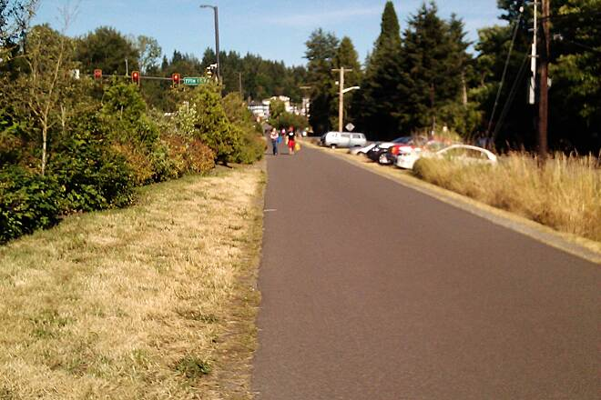 Burke-Gilman Trail Burke-Gilman Trail This is a view of the trail (adjacent to Kenmore Lanes)to show it is wide,paved,and maintained. There are areas here and there that aren't this smooth naturally from tree roots but overall it's perfect for long runs, biking, rollerblading, and walking.