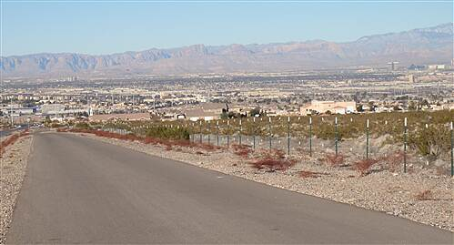 Burkholder Trail Burkholder Trail - Henderson, Nv. View is a zoom view long trail looking west over Henderson, with Las Vegas and Spring Mountains range in distant background