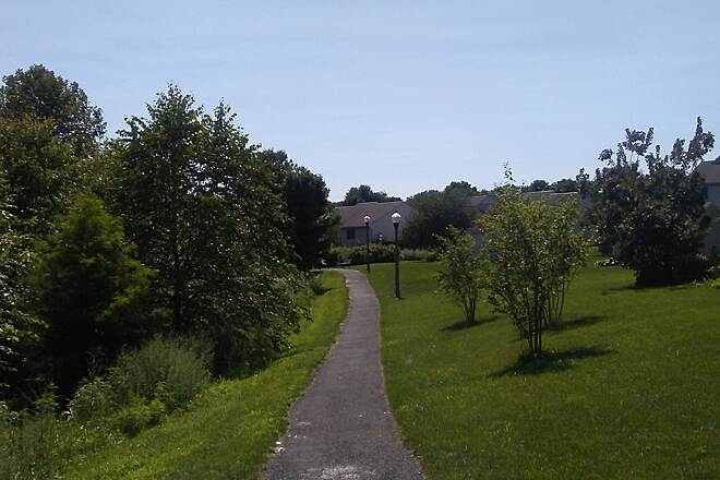 Butterfly Acres Trail Butterfly Acres Trail Looking west along the trail from the junction with Locust Street.