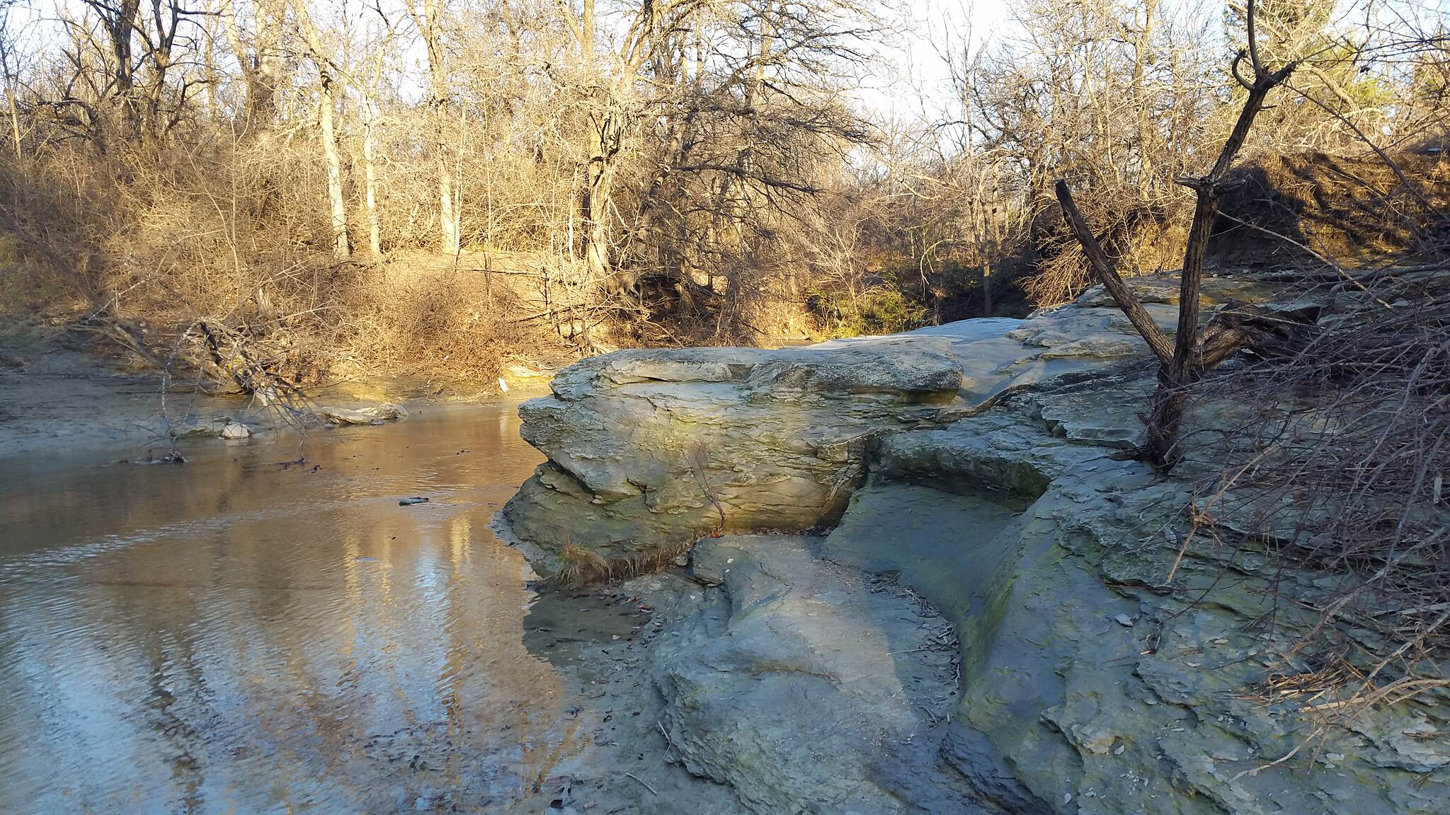 Caddo Trail Rock outcrop over Stewart Creek  Gorgeous and tranquil in in the middle of a bustling city