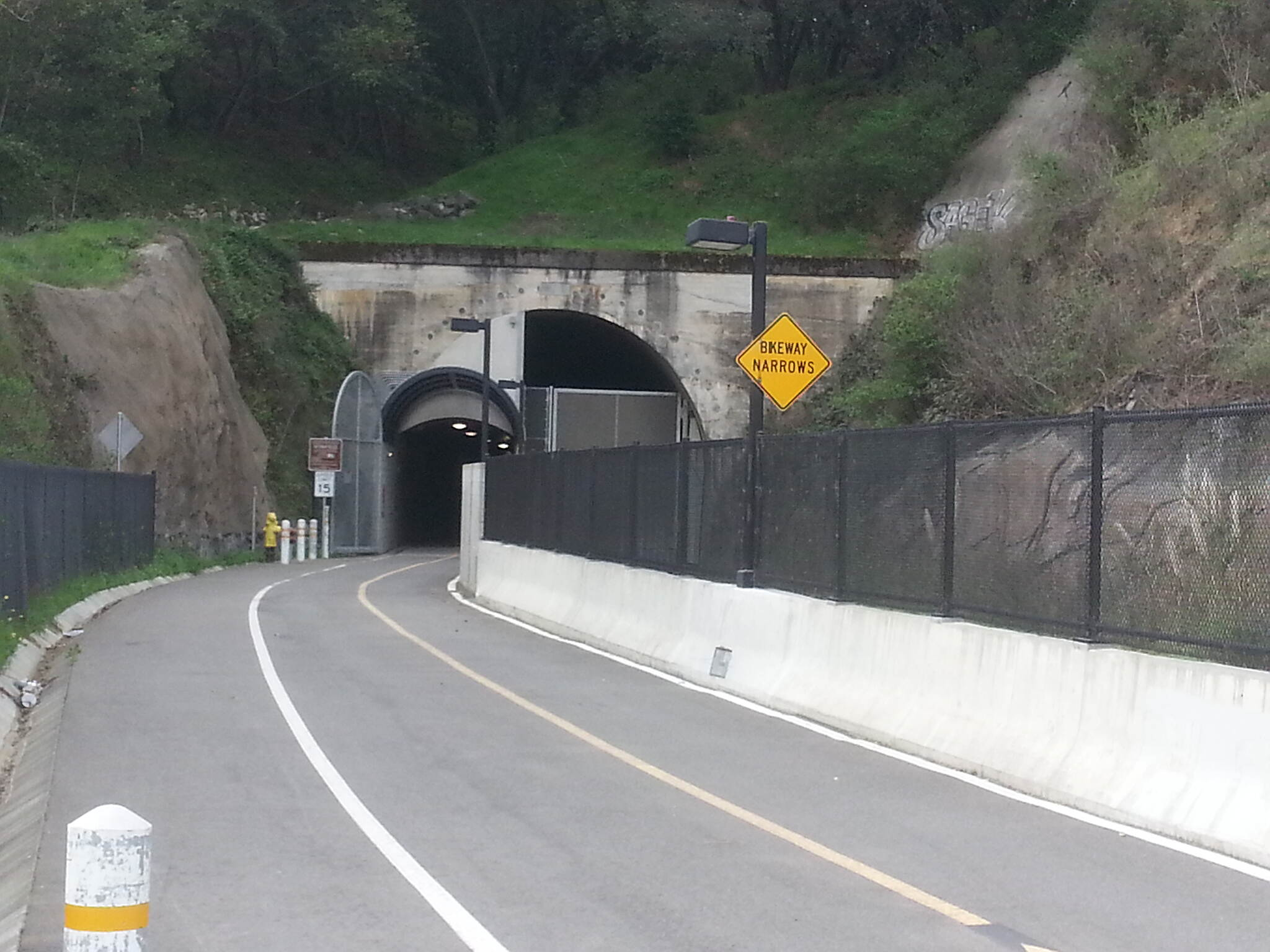 Cal Park Hill Tunnel North entrance to tunnel Tunnel is lit and has fans moving the air inside.