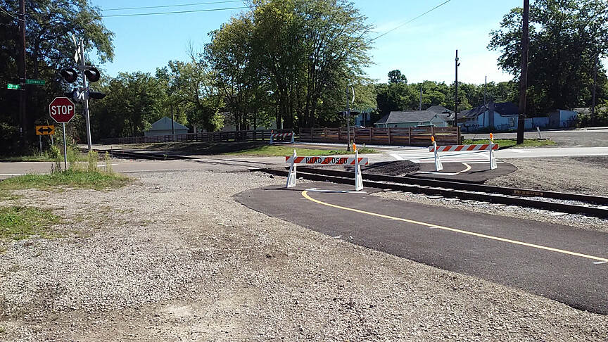 Camp Chase Trail Sept 2015 Eastbound, crossing Galloway Rd in Galloway, trail switches from North to South side of railroad, RR crossing still under construction