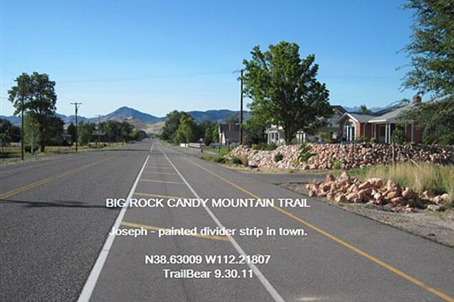 Candy Mountain Express Bike Trail BIG ROCK CANDY MOUNTAIN TRAIL A painted divider between road and trail in Joseph.