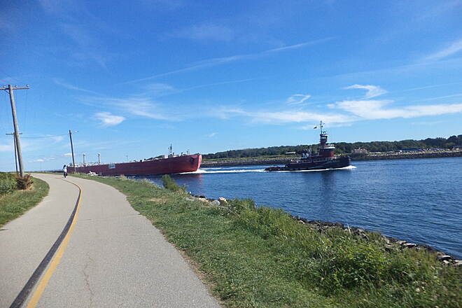 Cape Cod Canal Bikeway The North End of the Canal Tug and barge entering the canal from the Boston side.