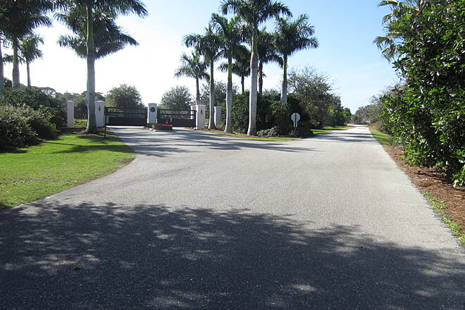 Cape Haze Pioneer Trail Coral Creek Country Club Entrance Coral Creek Country Club Entrance on left, the service area access road on the right is the Pioneer Trail.