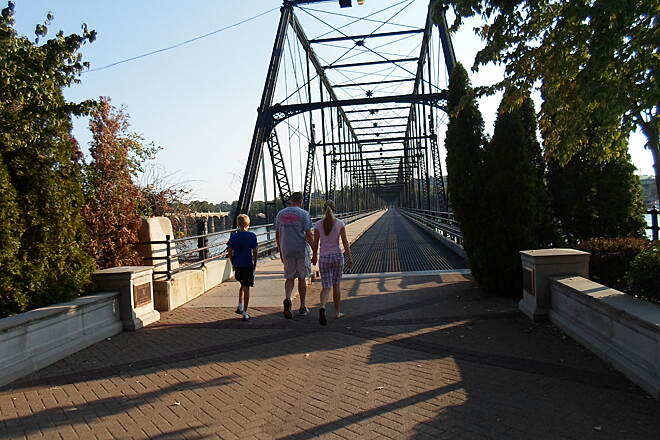 Capital Area Greenbelt Capital Area Greenbelt This family was taking an evening stroll on the Walnut Street Bridge, which connects the greenbelt to City Island. See the bridge's entry for more photos. Taken Aug. 2015.