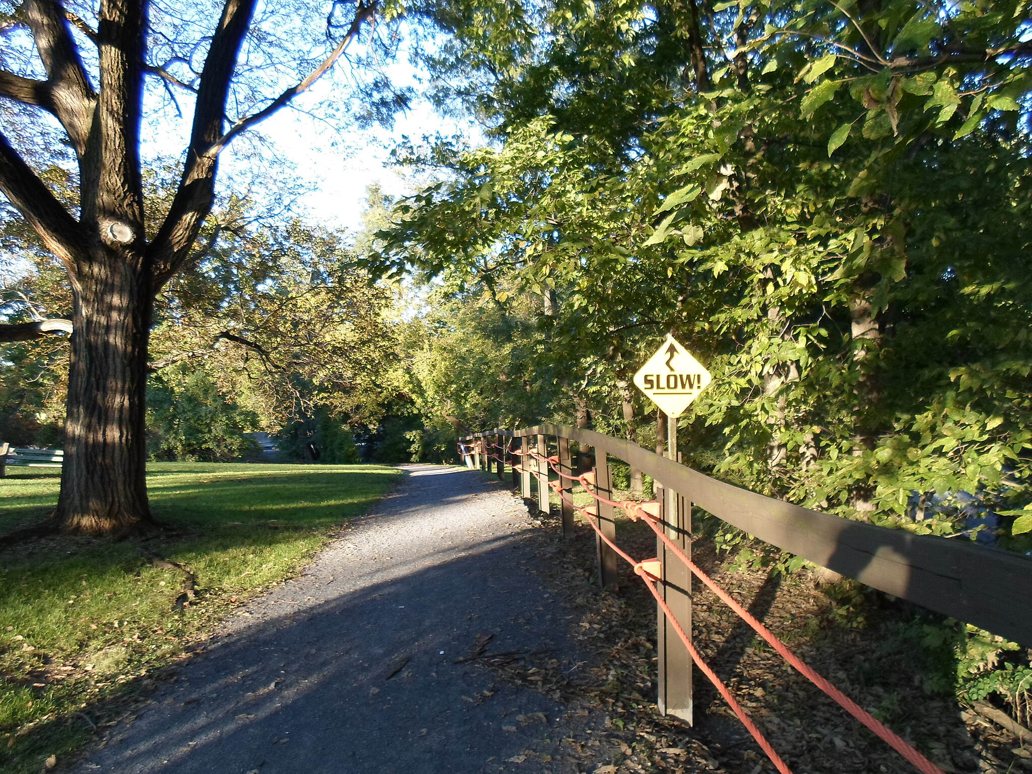 Capital Area Greenbelt Capital Area Greenbelt Sign warning users of the sharp curves on the northeast end of the Rutherford House property, where the trail abruptly turns east onto Spring Creek Bridge.