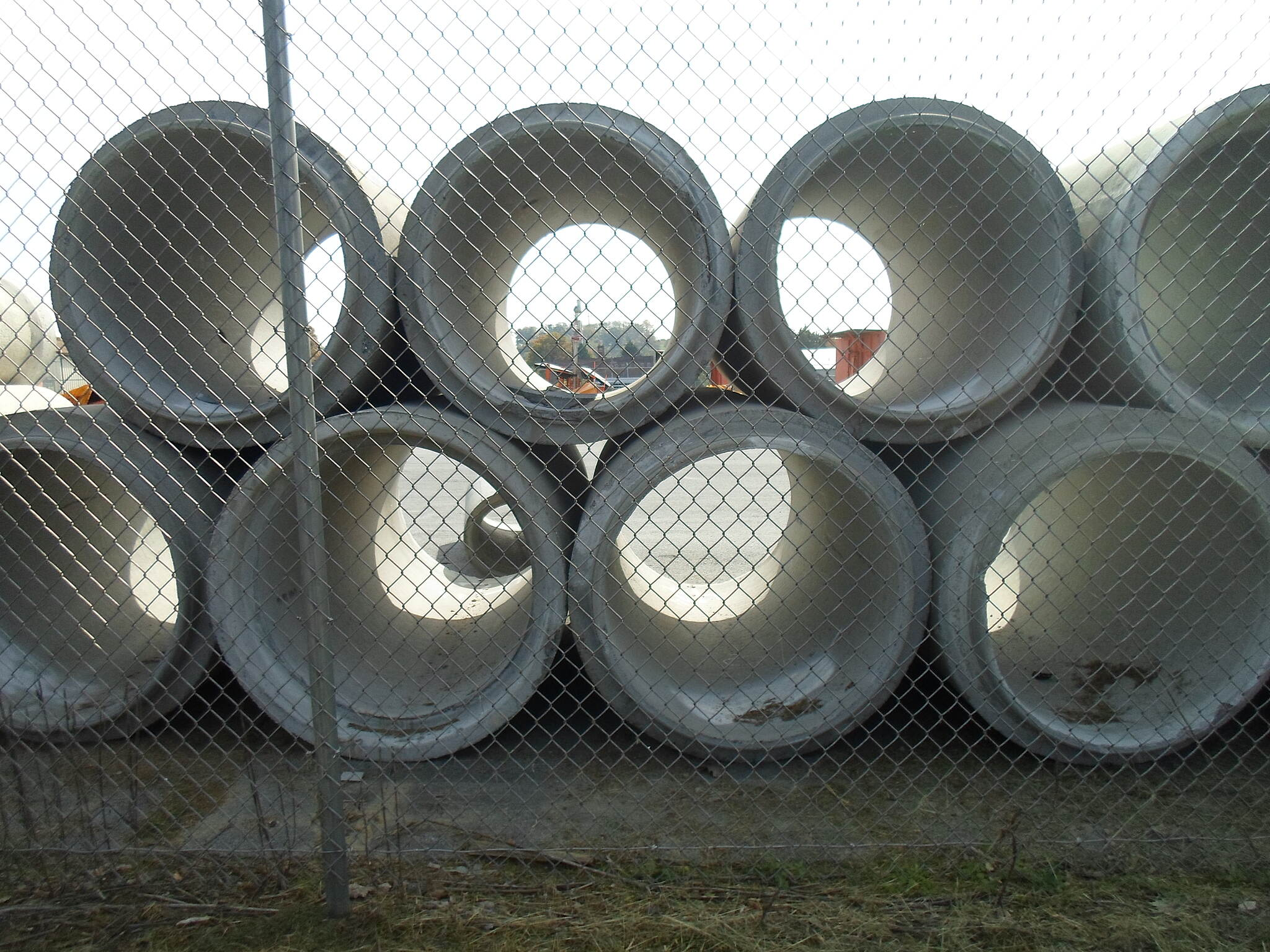 Capital Area Greenbelt Capital Area Greenbelt Giant pipes at the Penn DOT facility on the north side of the city, seen from the trail through a chainlink fence.