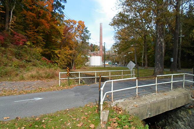 Capital Area Greenbelt Capital Area Greenbelt Bridge across a small stream on Pine Drive just west of the former state hospital. The trail crosses on a parallel footbridge.