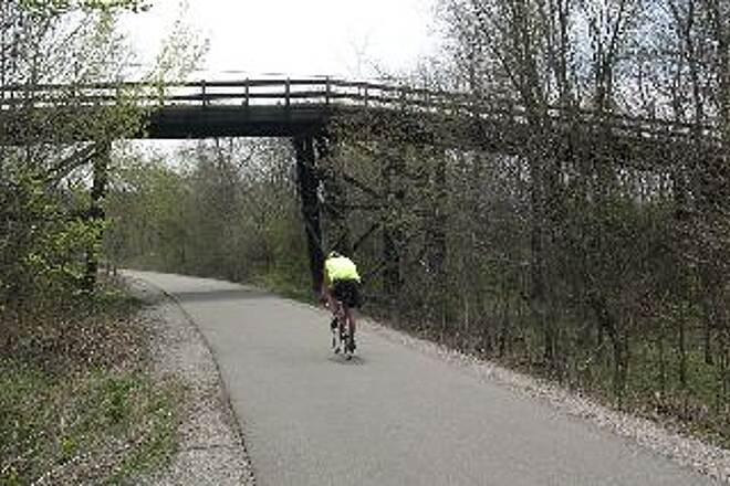 Cardinal Greenway Arched Wooden Bridge South of Muncie South of Muncie, the trail passes under a classic arched wooden automobile bridge still in use.