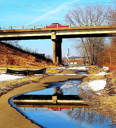 Cedar Valley Nature Trail Reflection off Bridge You never know what surprises you'll find on the trial.