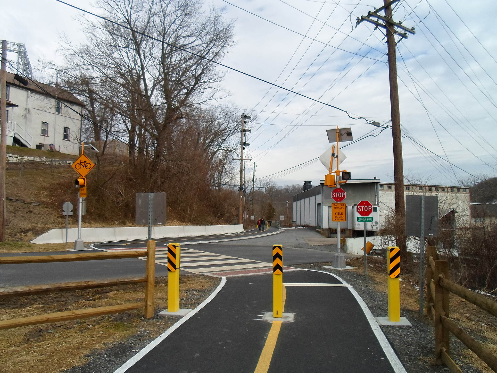 Chester Creek Trail Chester Creek Trail Lundgren Road crossing; the signals' lights flash to stop motorists whenever trail users approach.