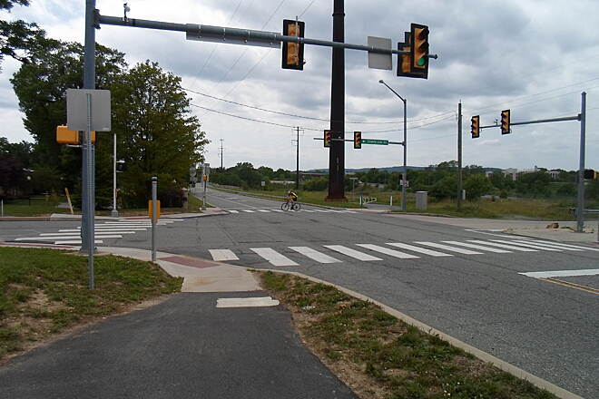 Chester Valley Trail Chester Valley Trail Crossing at Devon Park Drive and County Line Road at the Montgomery-Chester County border. The high number of at-grade intersections is one of the only drawbacks on the Chester Valley Trail.
