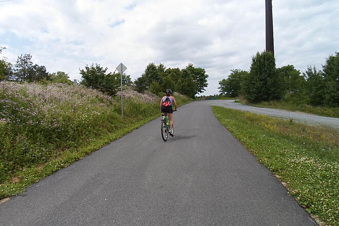 Chester Valley Trail Chester Valley Trail Cyclist getting ready to round the bend that takes the trail under Old Eagle School Road, immediately south of Route 202. Taken June 2015.