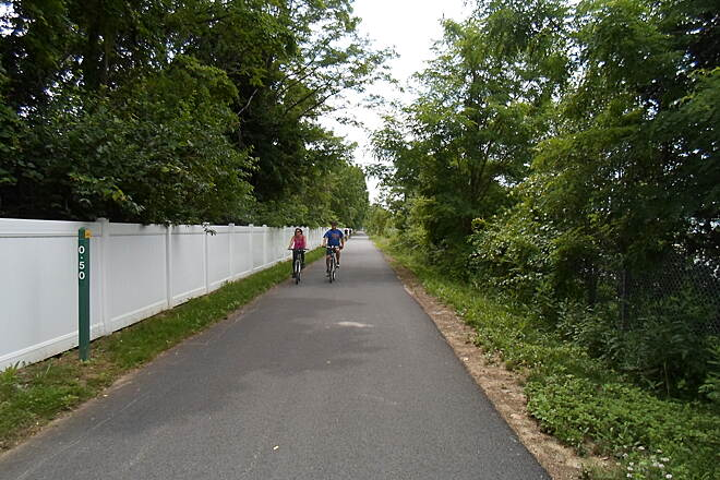 Chester Valley Trail Chester Valley Trail Cyclists approaching the half-mile mark in eastern Chester County; this is not the distance to the (current) eastern terminus of the trail, just the distance to the county line. Taken June 2015.