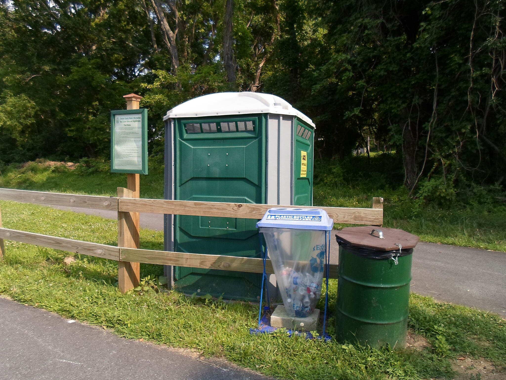 Chester Valley Trail Chester Valley Trail This chemical toilet, trash can and recycling bag are situated at the junction between the trail and the access path to Valley Road.