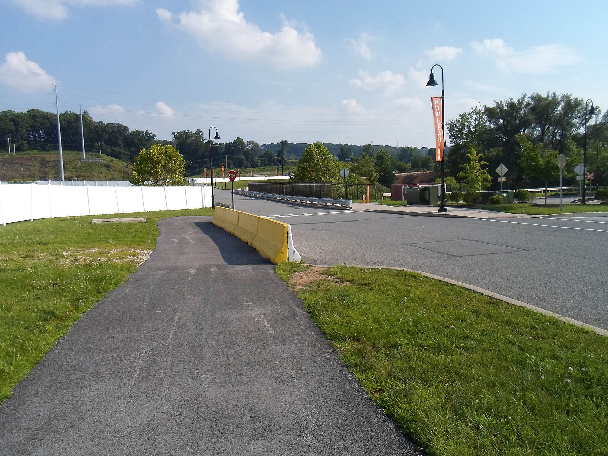 Chester Valley Trail Chester Valley Trail After rounding the bend at the intersection of Matthews Road and National Ave., the trail crosses the latter road, which it then parallels as a sidewalk to the Worthington Shopping Center. Taken July 2015.