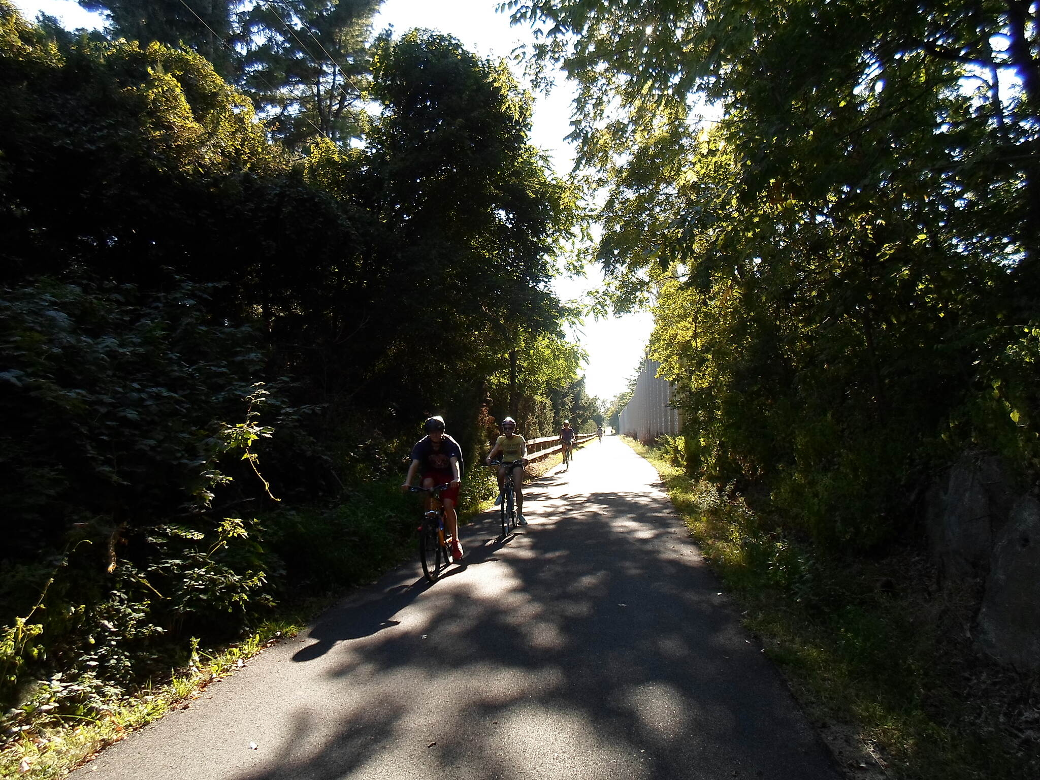 Chester Valley Trail Chester Valley Trail Cyclists entering the wooded area near the Contention Lane bridge.