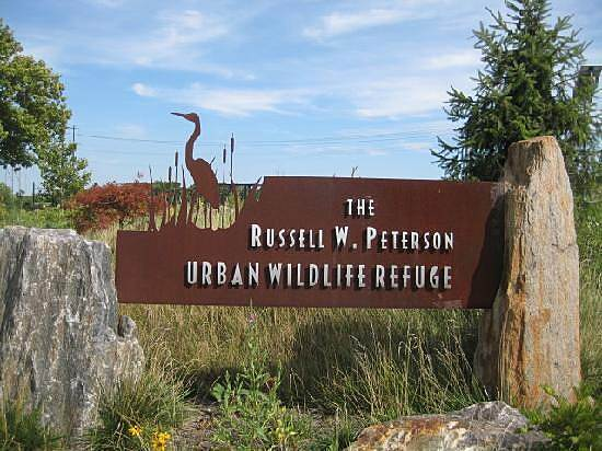 Christina Riverwalk Russell W. Peterson Urban Wildlife Refuge Sign for Russell W. Peterson Urban Wildlife Refuge at the end of the riverwalk.