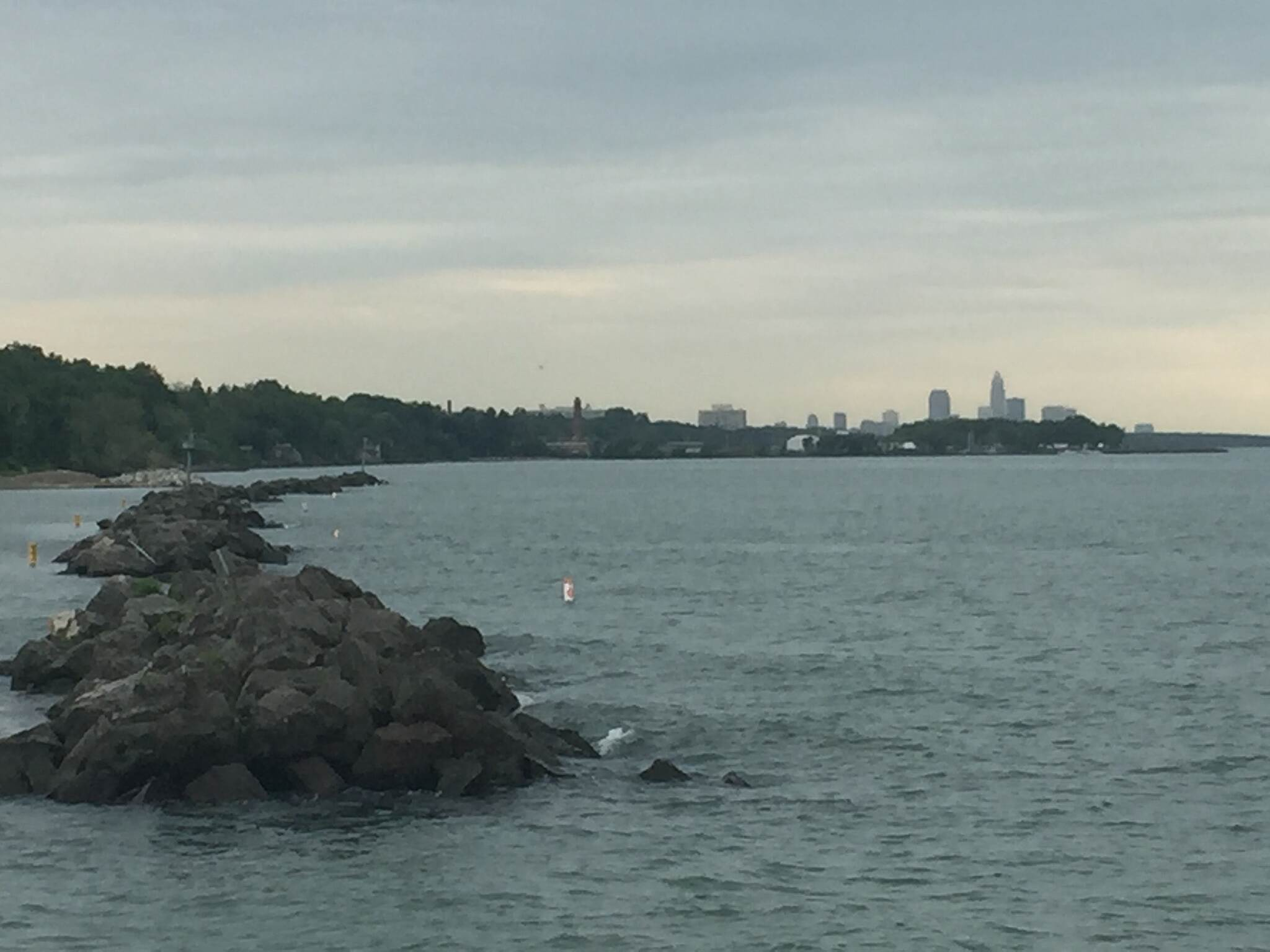 Cleveland Lakefront Bikeway Cleveland, Ohio Skyline A view of the downtown Cleveland, Ohio skyline from the pier near Euclid Beach on the southern shore of Lake Erie.  June 9, 2017.